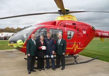 Picture of Brian Williams and Emlyn Newman presenting cheque to the Midlands Air Ambulance