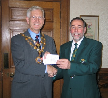Picture of Jim Griffith presenting cheques to the Mayor