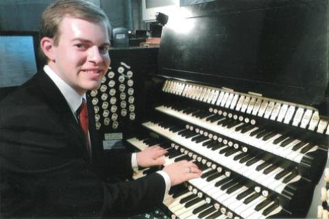 Picture of Michael Blake at the console of the Willis organ at Hereford Cathedral