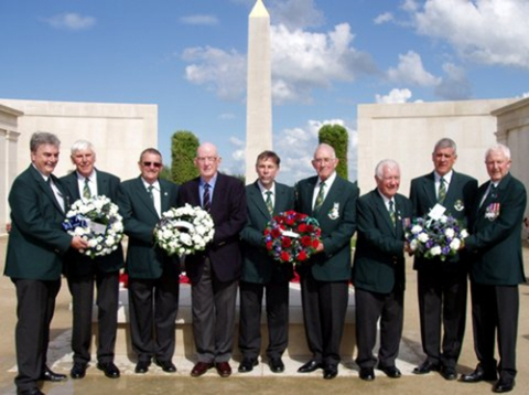 Picture of representatives of Hereford Police Choir laying wreaths at the National Memorial Arboretum
