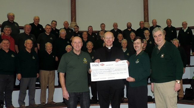 Picture of HPMC officers presenting the Dean of Hereford Cathedral with a cheque